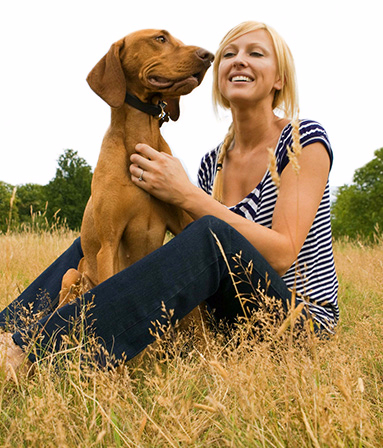 Happy woman with her beautiful brown dog